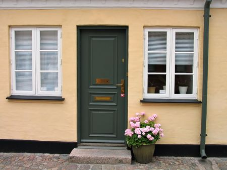 An entrance to country house decorated with flowers Denmark