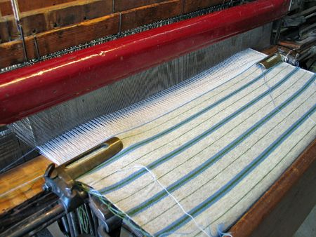 Weaving with a traditional old style handloom photo