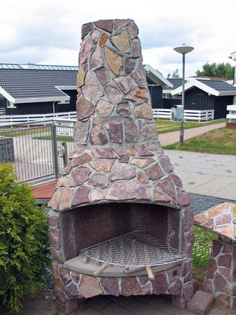 Outdoors rustic fireplace grill made of natural stones