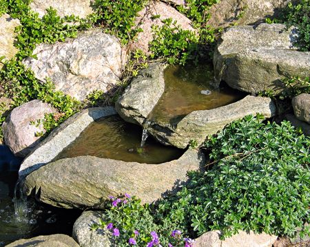 Beautiful decorative home garden stone waterfall photo