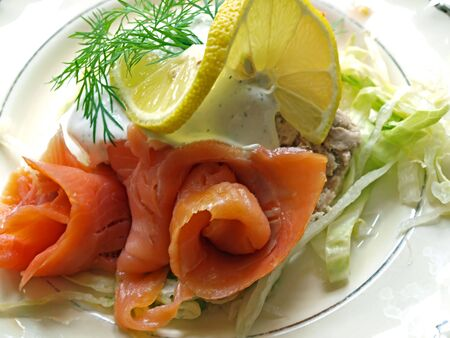 Fresh smoked salmon served with sauce and dill Stock fotó
