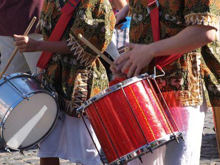 Brazil samba carnival musicians play on drums    Stock Photo