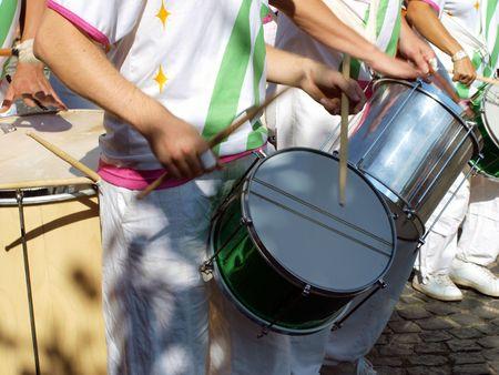 Samba carnival parade musicians play drums  Stock Photo