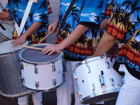Colorful Caribbean musicians play on drums  Stock Photo