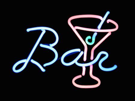 Neon bar martini cocktail sign on black background Standard-Bild