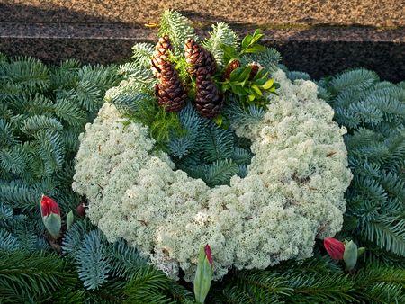 churchyard: Beatiful traditional decorative grave cemetery garland wreath