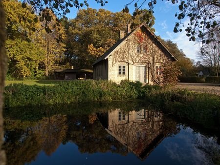 Beautiful countryside house reflected in a lake Denmark photo