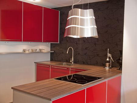 Modern design red kitchen with wooden counter Stock Photo