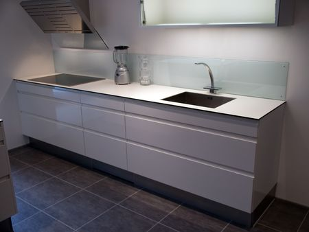 Modern design trendy kitchen with white wood elements, metal and glass Standard-Bild