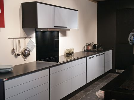 Modern design trendy kitchen with black and white wood elements and metal  Standard-Bild