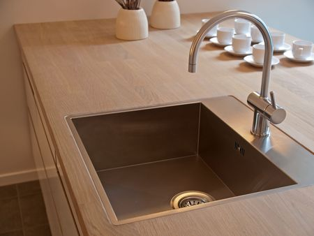 Details of modern design trendy kitchen sink with water tap
