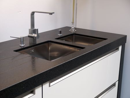 Details of modern design trendy  kitchen sink with water tap  Stock Photo - 4866939