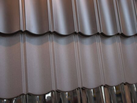 roofing material: Fragment of modern metal roof tiles in different colors Stock Photo