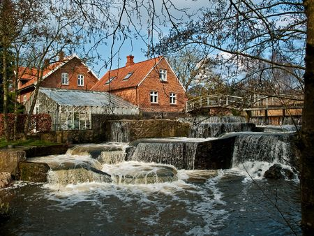Beautiful Waterfall Country Landscape Denmark - Zen motion falling water Stock Photo