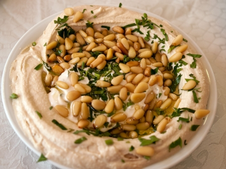 Dish of fresh Hummus with olive oil and parsley Middle East Arabic food