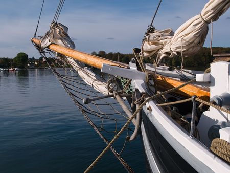 Traditional vintage wood sailboat sails out into the sea Stock Photo - 5722163