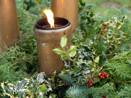 Christmas spruce tree European Holly corners and festive torch lights Stock Photo - 5817516