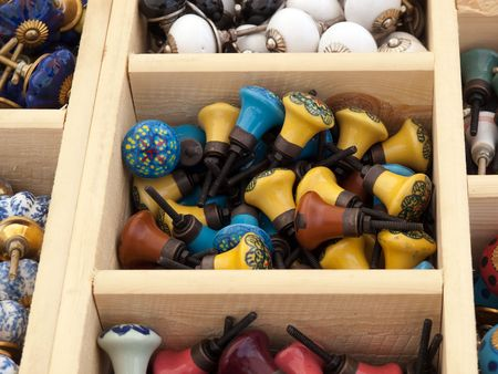 Colorful selection of DIY cabinets parts knobs for sale on display Stock Photo