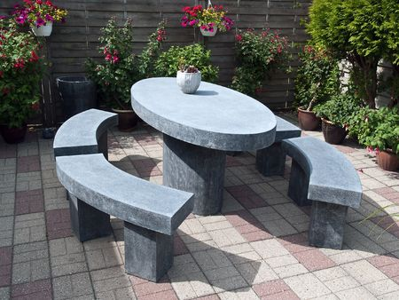 Beautiful garden patio seating corner made from stone photo