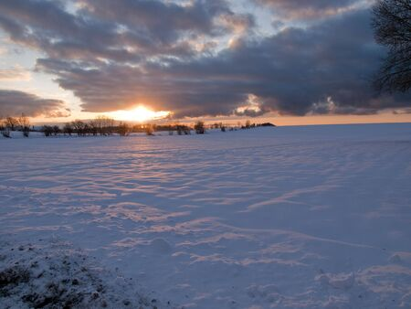 Magical beautiful winter sunset in a snow field landscape background Stock Photo - 6142163