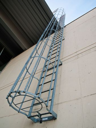 Fire emergency escape ladder on a building vertical angle photo