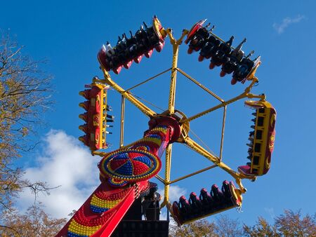 chairoplane: Giant modern colorful merry-go-round chairoplane in an amusement park Stock Photo