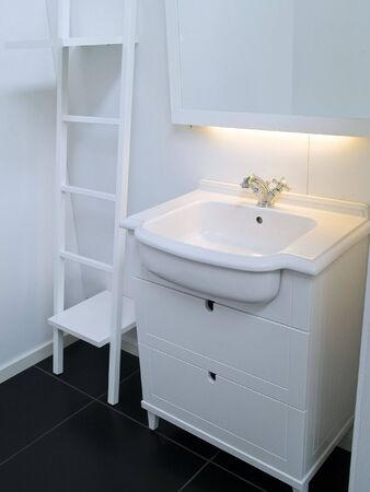 Details of a modern trendy contemporary designer bathroom in all white elements Stock Photo - 7869217