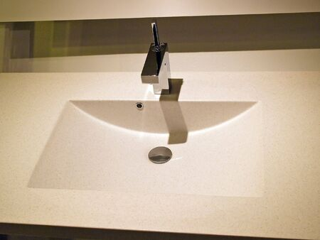 Modern contemporary designer bathroom sink and tap details photo