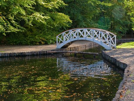 Beautiful small wooden footbridge in Tivoli Arhus Denmark photo
