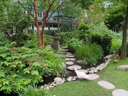 garden lamp: Beautiful classical landscaped Japanese garden with water stream and walkpath