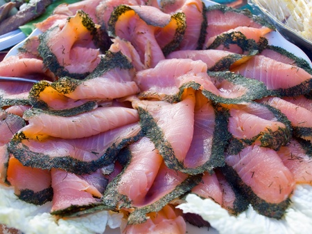 Fresh smoked salmon served with sauce and dill - Scandinavia food background