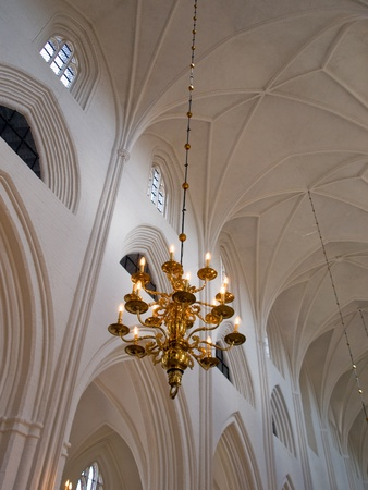 Classical Style Old Beautiful Crystal Chandelier hanged in a church