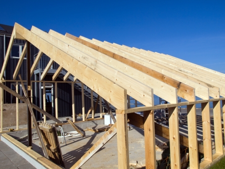 Details of a wooden house building frame under construction photo