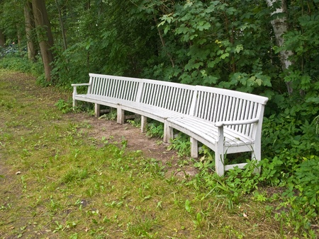 Beautiful classical design park garden wood bench seating corner  photo
