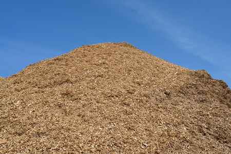 Pile of wood chips mulch for gardening and heating background