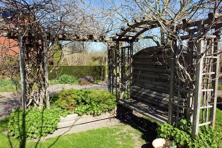 Beautiful small wooden garden pergola gazebo arbor photo