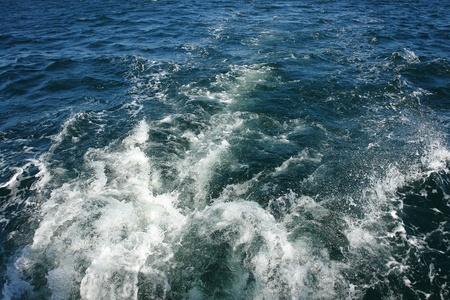over the sea: Large boat water wake trail left over the sea ocean - great boating sailing background