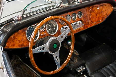 car detail: Interior and dashboard detail of a restored retro soft-top British made classical sports car