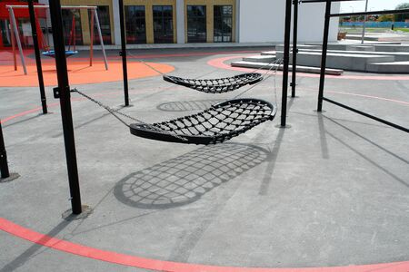 Modern creative design city playground swings made from metal and ropes