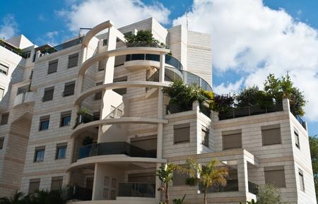 Modern design luxurious executive apartments city condominium building with green gardens Editorial