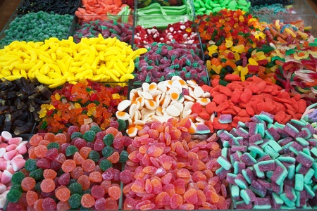 Wide selection of colorful wine gum sweets candies for sale in a shop Stock Photo - 11488663