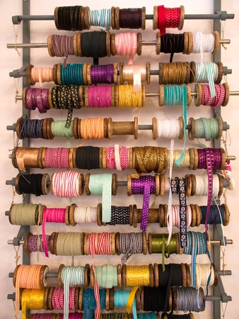 Variety selection of decorative colorful ribbons in hand craft shop photo