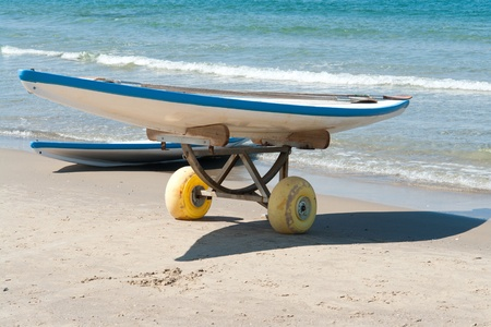 Classical surf boards on a  sandy beach ready for extreme action sport