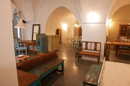 Interiors of classical traditional luxury Arab house with stone arches and furniture