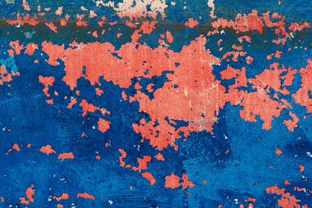 Rusty grunge aged steel iron paint on an old boat texture background in red and blue                                photo
