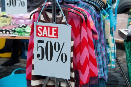 price reduction: Sale signs in a fashion market stand special offers Stock Photo