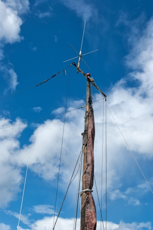 jib: Foresail, Jib, and Wooden Mast of a sailing yacht vertical perspective boating background