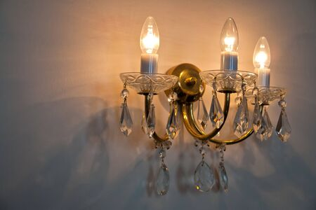 crystal chandelier: Classical Style Old Beautiful Crystal Chandelier on the wall   Stock Photo