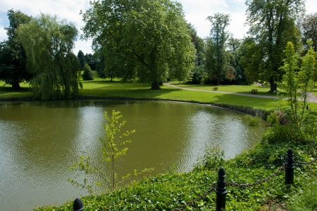 garden of eden: Beautifuln garden with  lawns and trees by a lake in classical mansion estate Denmark Stock Photo