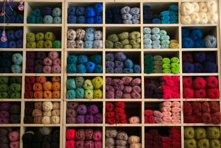 Selection of coloful yarn wool on display in a shop